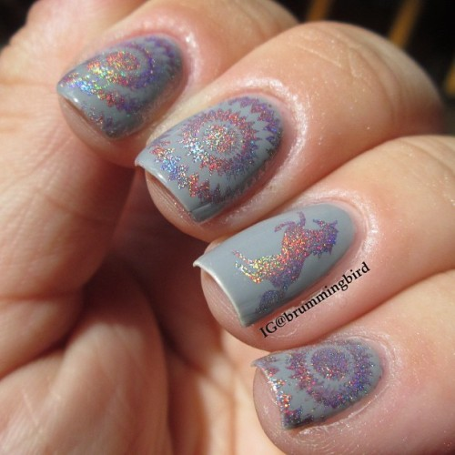 "truthteller:  Holo stamping with Wistonia plates over an unnamed grey polish from a ""The New Black"" set."