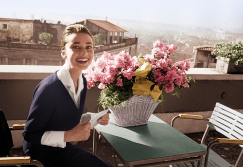 conveys:  absinthemakesyouawhore:  Audrey Hepburn on the terrace of the Hotel Hassler, in Rome, with the telegram announcing her best-actress award, for The Nun's Story, from the New York Film Critics Circle, 1960. (via)  ILY