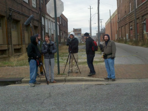 Lights, Camera, Bullshit! The crew setting up in downtown Memphis, Tn.  Chad Barton - Director Eric Huber - Director of Photography  Shelby Baldock - Camera #2 Charlie Metz III - grip, lights, dolly (everything to everyone) Craig Manners - Boom Operator  Adam Knych - grip, extra on camera Charlie is almost always waving in every picture i've even snapped of him.