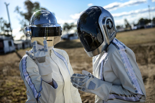 Fans wearing Daft Punk helmets arrive at a venue in Australia's tiny town of Wee Waa prior to the French band's album launch this morning. Wee Waa, better known for cotton-picking than culture, was relishing the limelight as thousands of electo-pop fans descended on it. The cotton town's population will more than double for the event. Photograph: Shanna Whan/AFP/Getty Images