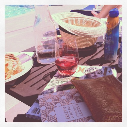 Some light #gatsby reading & our rosé gold pouch  (at Pool @ Coppola Winery)