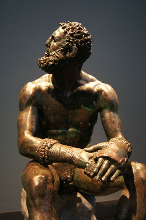 Boxer of Quirinal - A Hellenistic Greek sculpture dated to around 330 b.c. It's a sculpture of a defeated boxer, complete with caestus, or leather handwraps, still wrapped around his fists. Look at the cauliflower ear, the cuts, and the swollen face. It's straight out of the latest pay-per-view but this was created more than 2,300 years ago.  This is divine.