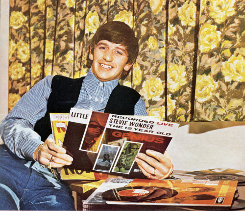 theretrothomas:   Ringo Starr with his vinyl records. c. 1964.   Not my scan/edit! Are you the owner? Please contact.