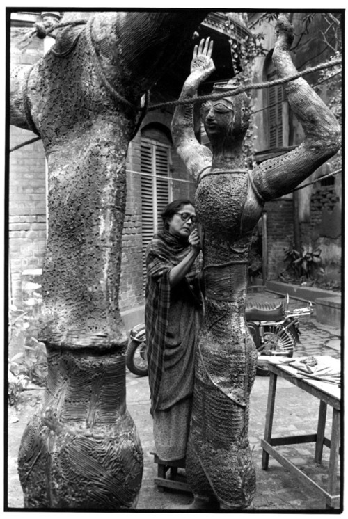 yama-bato:   Woman working on a sculpture in a courtyard. Creator Gedney, William Gale, 1932-1989