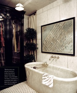 This bathroom is perfection with the intimate space filled with marble, art, a clothing armoire, and a topiary. #GEM