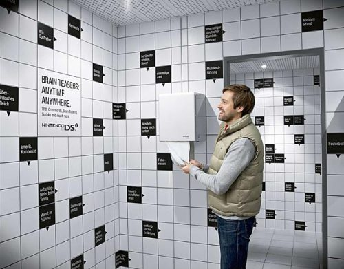"Ogilvy & Mather, Frankfurt came up with the creative indoor ambient solution in 2009 to transform tiled walls of customer toilets of several shopping malls in Germany into huge crossword puzzles to promote the game ""Brain Teaser"" of the Nintendo DSi console By the way, I would have gone to the bathroom with black marker. : )"