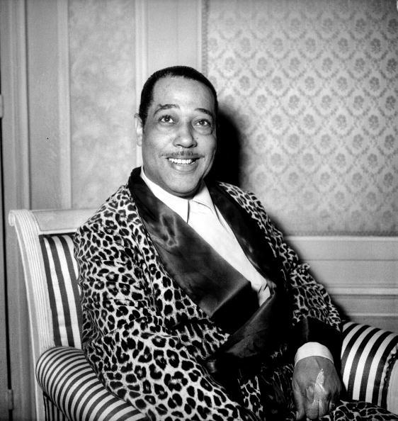 "vintageblackglamour:  Edward Kennedy ""Duke"" Ellington was born 114 years ago today in Washington, D.C. In this April 1950 photo, he is illustrating part of the reason the name ""Duke"" was bestowed upon him by childhood friends who admired him for his killer style. He even wore suits and ties in high school and once blew everyone away at a party when he showed up in a shimmy back herringbone suit that was shirred and pleated in the back—a style that no one else was wearing at the time. Photo by Lipnitzki/Roger Viollet/Getty Images."