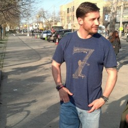 Tom Hardy modelling his new Blag shirt on set of Animal Rescue   © Paige Cameron