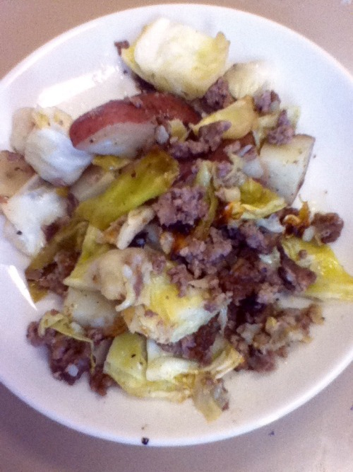 Roasted Irish dinner: cabbage and potatoes seasoned and covered in olive oil, mixed with ground beef and put in the oven. I think I've found a new favorite.