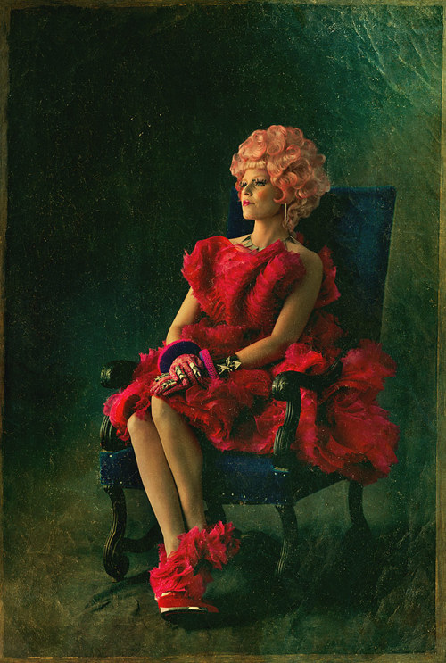 suicideblonde:  Elizabeth Banks (in Alexander McQueen) as Effie in The Hunger Games: Catching Fire