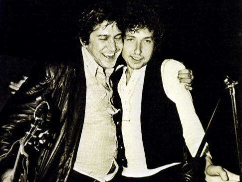 Phil Ochs and Bob Dylan at the Chile benefit concert, 1974. Dylan bailed out his old friend and rival Ochs at the last minute by agreeing to join the Madison Square Garden Felt Forum (now Theater at MSG) show in memory of Salvador Allende, Victor Jara and other victims of the 1973 coup. The poorly-selling show, threatened with cancellation, sold out within minutes of the announcement on WBAI that Dylan would appear.