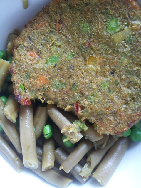 Simple lunch. Dr. Praeger's California burger with green beans and peas.