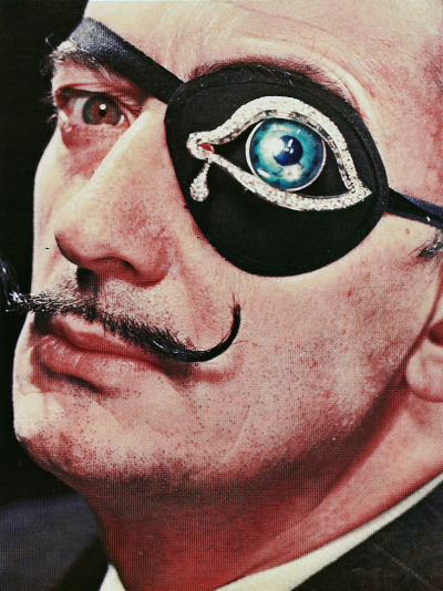 More pictures of Dali's famous eye brooch, both found on Retronaut.