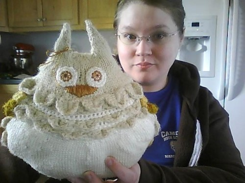 "elizabethplaid:  OWL PILLOW! Inspired by the Roderick on the Line episode in which John Roderick tells us about his pillows turning into owls. Bridget's cross stitch (inspired by the same episode) caught my attention first, so she's the bigger inspiration to me. Made by me, using bits of patterns here and there. I used the crocodile stitch motif to make the ""feathers"" and Purl Bee's giant owl pattern for making the eyes (basically crocheted circles) and ears. Bonus: Owl Pillows was created the day before I finished embroidering my owl's beak.PS: I apologize if it looks like Totoro. The ears seem to have made it less owl-y, and the embroidered beak resembles a big nose.   This is awesome. Just like you. <3"