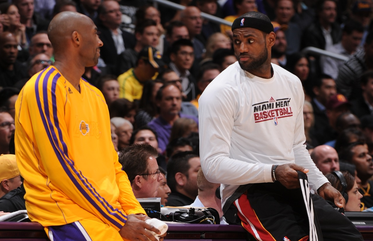 nba:  Kobe Bryant of the Los Angeles Lakers and LeBron James of the Miami Heat share a word as they wait to check in at Staples Center on January 15, 2013 in Los Angeles, California. (Photo by Andrew D. Bernstein/NBAE via Getty Images)