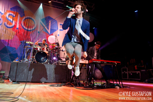 Michael Angelakos of Passion Pit grabs some air at the 2013 Sweetlife Festival.