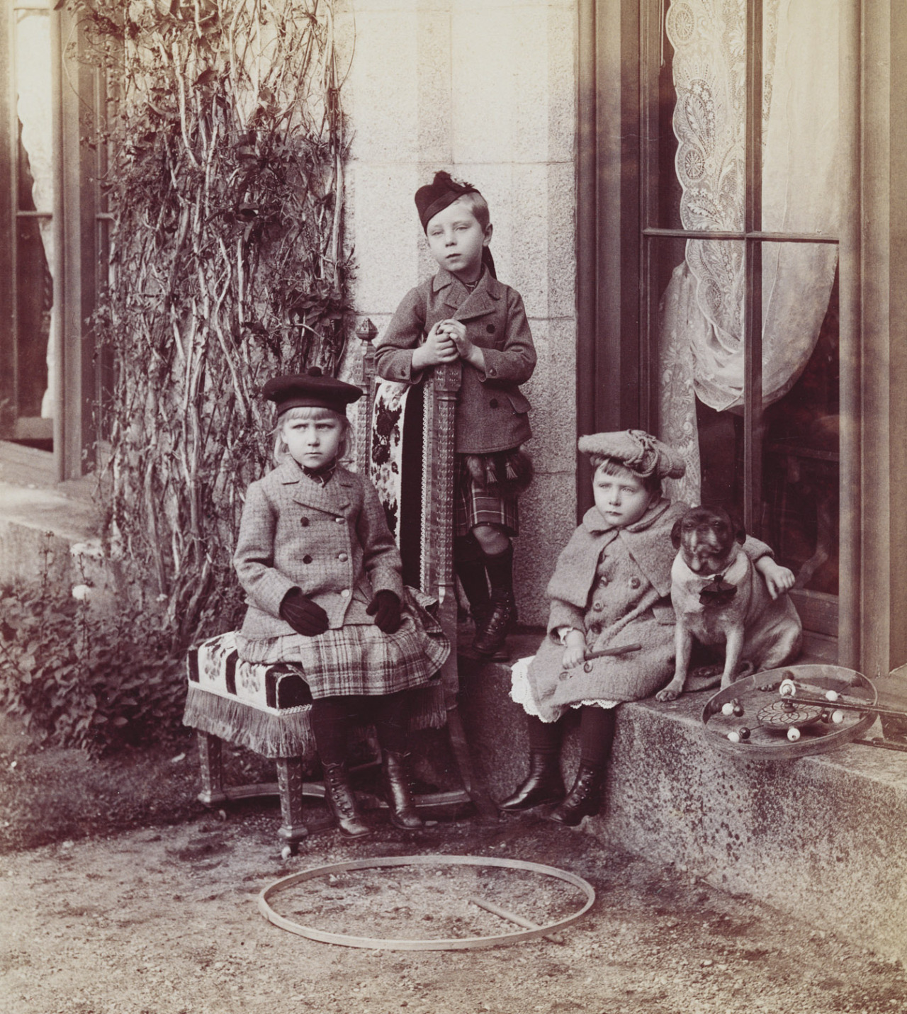 The three eldest children of Princess Beatrice and Prince Henry of Battenberg, with a pug, at Balmoral in September 1891. From left to right: Princess Victoria Eugenie (1887-1969); Prince Alexander (1886-1960) and Prince Leopold (1889-1922). Princess Victoria, known as Ena, subsequently married King Alfonso XIII of Spain.