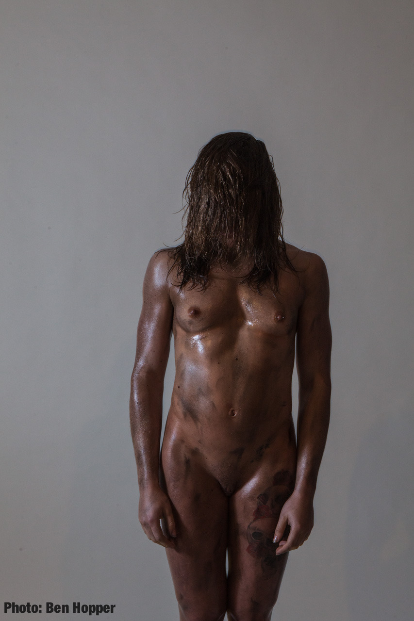 Girl with muscles and hair covering her face