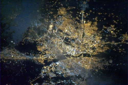 colchrishadfield:  Delhi, India. So many people, their lights shining in the night up into space.