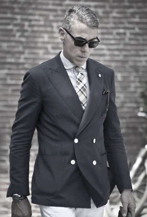 suitdup:  Cool but is he carrying two pairs of shades? Haha.