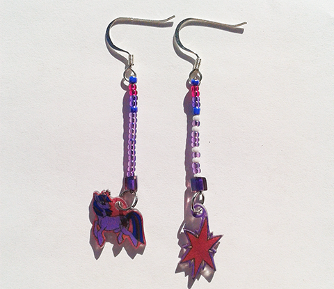 Earrings featuring Twilight sparkle from MLP: FiM. If you are interested in seeing more pictures or perhaps even buying it you can visit it here!