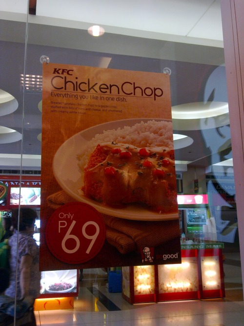 "KFC Chicken Chop It's KFC's newest dish. The Chicken Chop: deep-fried chicken fillet, stuffed with cheese and ham, covered with a creamy white sauce. That's on paper. Now the actual: the fillet didn't taste like chicken.  It was salty, similar to those ""chicken"" nuggets found in the supermarket.  There was barely any cheese and ham.  And the sauce?  Well, does it look white?  To be fair though, it had good consistency.  It was sweeter than the regular KFC gravy.  The carrots and the herbs were a nice touch. An order costs Php 69. Try it and judge for yourself."