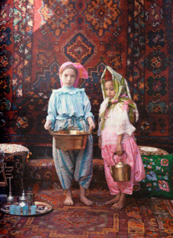 natgeofound:  Children attendants gather supplies for an Arab diner in Algeria, February 1928.Photograph by Jules Gervais Courtellemont, National Geographic