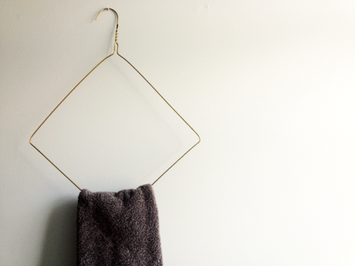 Wire Hanger Towel Holder {How to} Found at: adailysomething