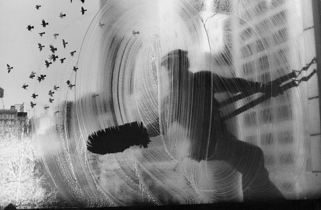 brianluman:  hotparade:  Harold Feinstein -  Window Washer & Flock of Pigeons, 23rd Street Loft, New York City, 1972  A perfect picture. I need to make some of these.