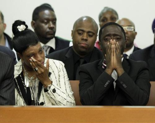 "TW: Police brutality - Judge tosses indictment in Ramarley Graham case, says grand jury was misled May 15, 2013 A judge has thrown out the indictment against an NYPD officer charged in the fatal shooting of an unarmed 18-year-old in his Bronx home last year, but said prosecutors can present the case again, NBC 4 New York has learned.      Officer Richard Haste, 31, had been indicted on manslaughter charges in the February 2012 shooting death of Ramarley Graham and faced up to 25 years in prison.  On Wednesday, a judge dismissed the indictment on a technicality, siding with defense lawyers who had argued prosecutors gave flawed instructions to the grand jury that indicted Haste. The Bronx district attorney's office couldn't immediately be reached for comment.  Graham's family left the courtroom after the judge's decision, cursing and calling the officer a ""murderer."" Graham was shot to death in the bathroom of his home on East 229th Street after police chased him inside. Security video showed Graham entering his home, and police running after him. Police at the time said officers witnessed a drug deal and pursued Graham, believing he had a gun. They went in and found him in the second-floor bathroom, and shot him in the chest. He died shortly afterward. Police said later that Graham was not found with a gun. Source ""This is an outrageous miscarriage of justice and an insult to the family and supporters of Ramarley Graham. We demand that a new Grand Jury is convened immediately and that the case is re-presented."" - Rev. Al Sharpton Pictured: Ramarley's parents, Franclot Graham & Constance Malcolm"