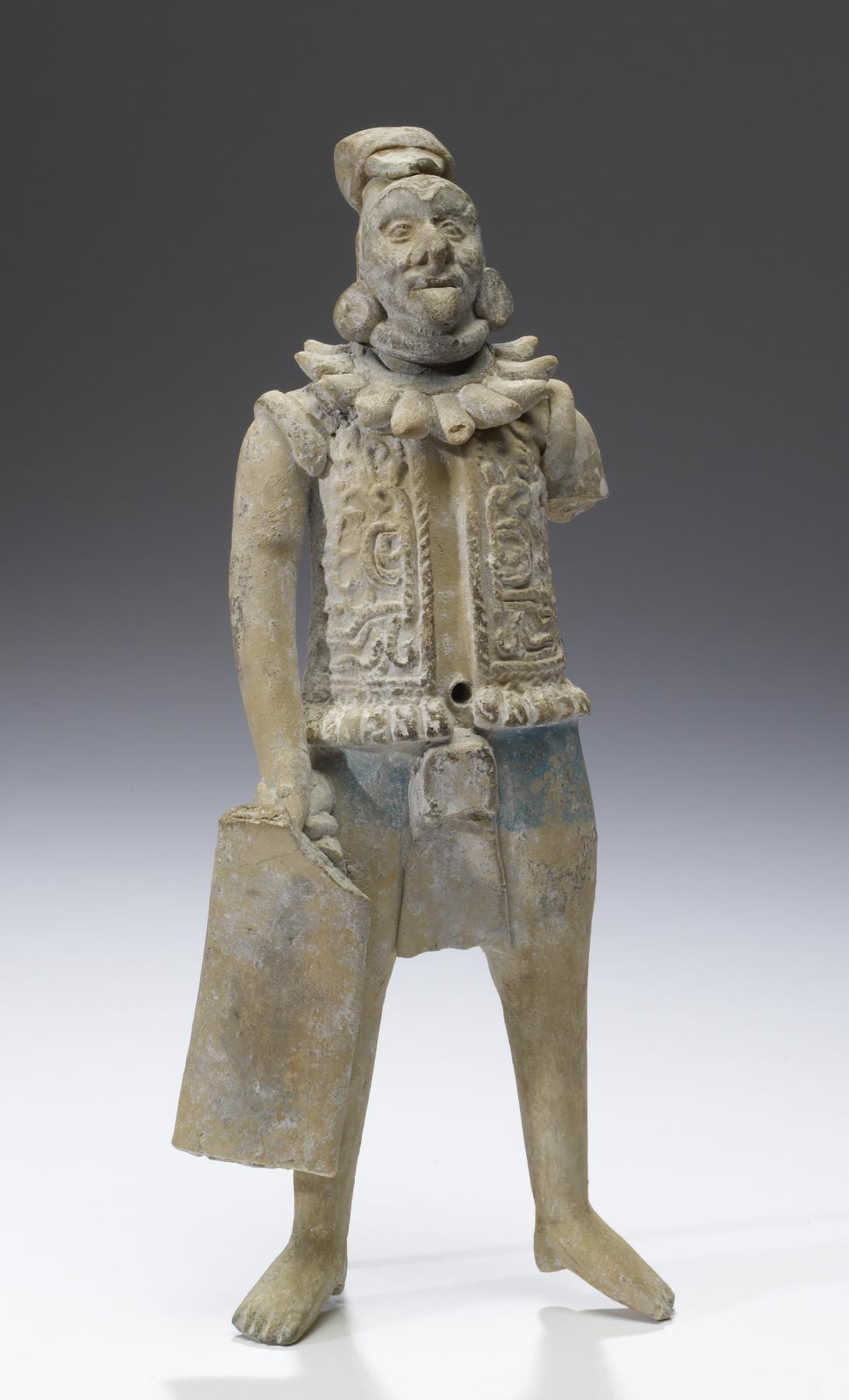ancientart:  Mayan Warrior Figurine, AD 550-850 (Late Classic), made of earthenware, post-fire paint.  Among the most renowned of the myriad figurine traditions of Mesoamerica is that of Jaina Island, a residential and funerary settlement adjacent to the coast of west-central Campeche. Jaina Island's extensive burial grounds have been known since the nineteenth century, but only in the 1940s were they first scientifically excavated. Archaeologists found figurines in the arms of the deceased who had been dressed in their finest clothes and wrapped in cotton burial shrouds and palm-fiber mats. The renowned Mexico archaeologist Román Piña Chan, the director of excavations at Jaina, has speculated that the figurines served to ensure the deceased's lifeways and social position in the afterlife. This figurine is notable because it portrays an elderly warrior rather than the robust young combatant so typical of Classic Maya figurines. His identity is confirmed by the flexible, rectangular shield held in his right hand and the quilted armor tunic, both being requisite garb for Maya warriors. He likely represents a captured warrior, defiant yet stately in demeanor, his defeat indicated by the thick rope binding his neck and upper arms. The form of the head suggests that the figure originally was adorned with a removable headdress which has been lost.   Courtesy & currently located at the Walters Art Museum, USA.