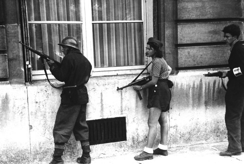August 29, 1944. A girl of the resistance movement is a member of a patrol to rout out the Germans snipers still left in areas in Paris, France. The girl had killed two Germans in the Paris Fighting two days previously.