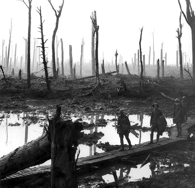 Australian gunners on a duckboard track, Battle of Passchendaele, October 29, 1917. Photo by Frank Hurley.