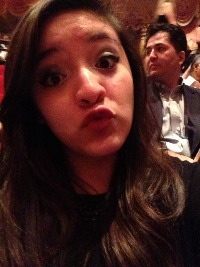 Me at Les Misérables. Enjoy the innocent bystander in the background.