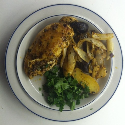 Harissa rubbed chicken with cilantro and garlic, roasted potato and onion. #Harissa #cilantro #roastchicken #dinner