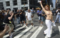Topless in NYC, appearantly its ok  today Ladies of New York , you are free to walk bare-breasted through the city! New York City's 34,000 police officers have been instructed that, should they encounter a woman in public who is shirtless but obeying the law, they should not arrest her. This is a good step towards gender parity in public spaces.