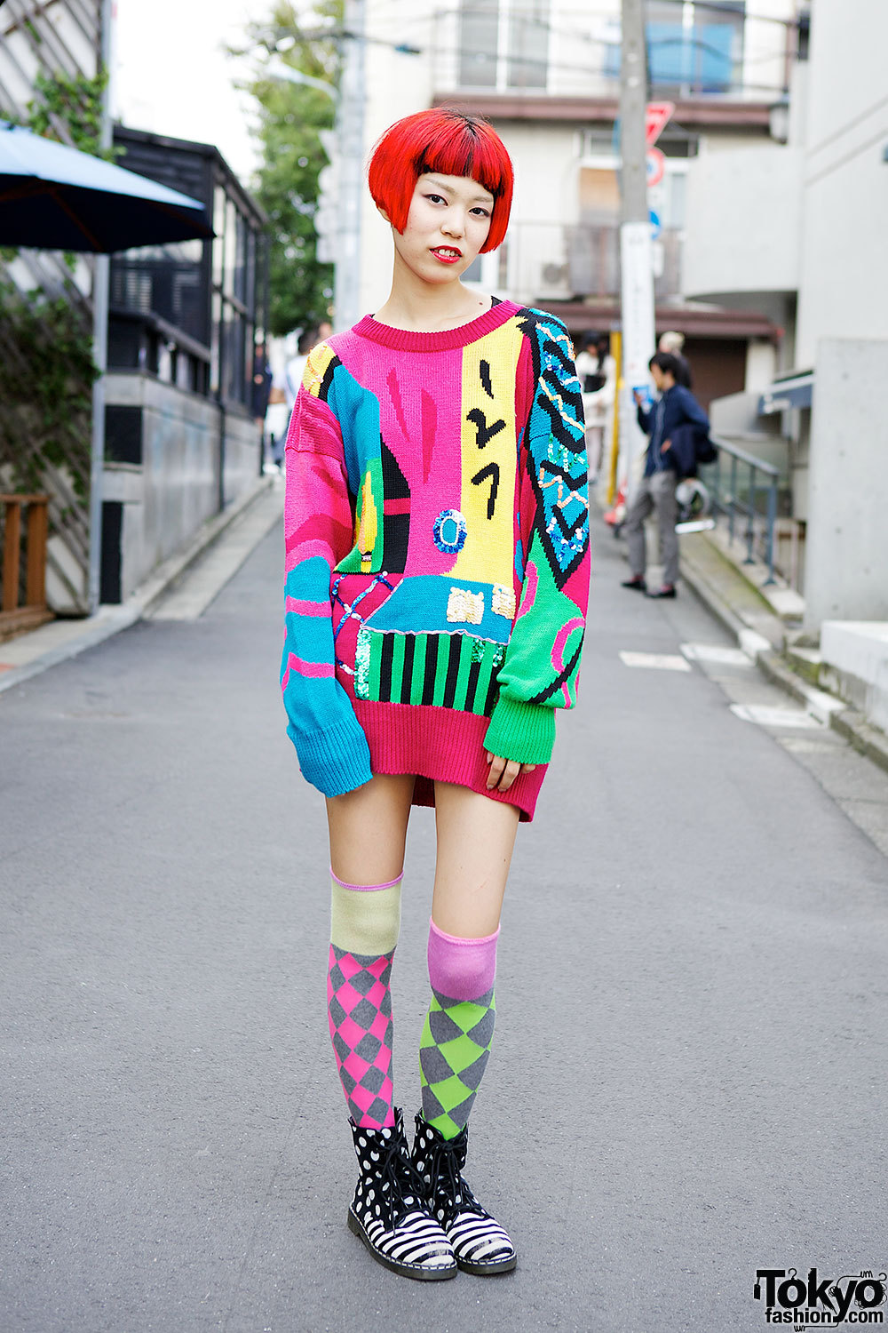 The Circus Harajuku staffer w/ red hair & lips, oversize resale sweater, colorful socks & 24 Footwear boots.