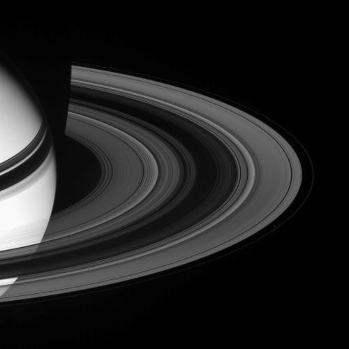 Sunlight scatters through Saturn's rings, emerging on the unilluminated side. Prometheus (102 kilometers, or 63 miles across, lower right) and Pandora (84 kilometers, or 52 miles across, upper left) are visible here, respectively internal and external to the narrow F ring. This view looks toward the rings from about 17 degrees above the ringplane. The planet's shadow darkens the rings near upper left.