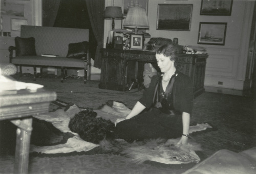 Daisy Suckley plays with Fala in FDR's White House Study, December 20, 1941. (FDR Presidential Library & Museum)