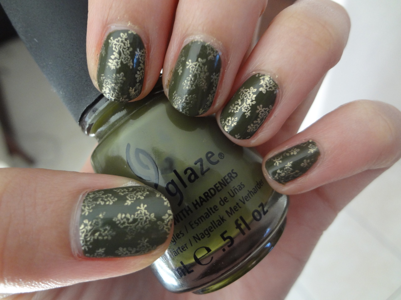 stephanieanguyen:  Olive Branch Nails China Glaze's Westside Warrior, Konad plate m71 stamped with CND's Gold Chrome