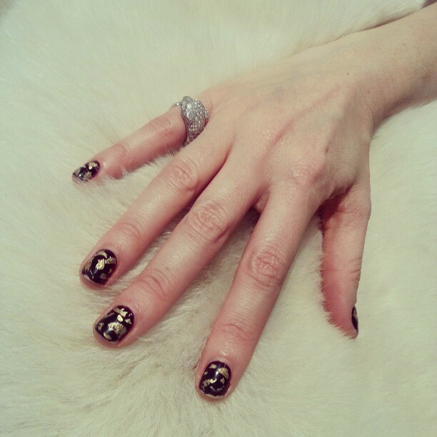 evachen212:  Another day, another manicure: gold-flecked oxblood on Cassandra Grey, founder of Hollywood-chic beauty site The Violet Files… check it out!   This is fab but I would destroy it in under an hour.
