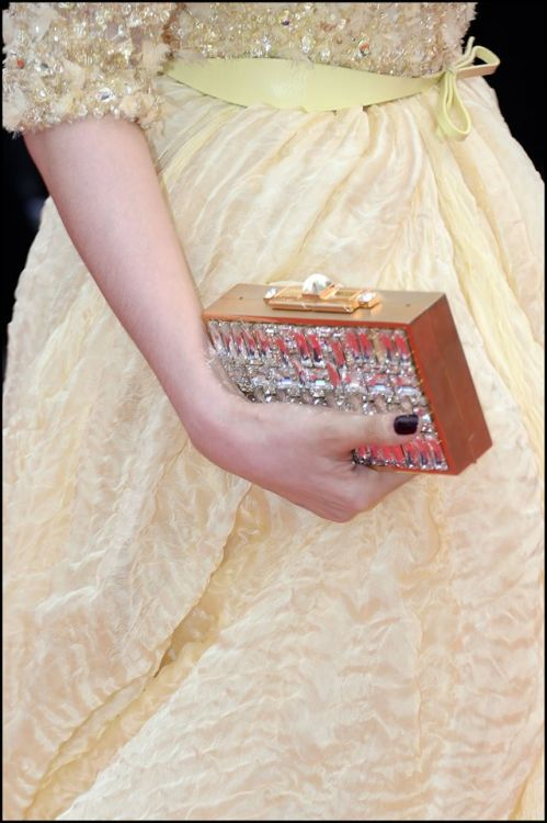 eliesaab:  A closer look at the ELIE SAAB evening bag worn by Fan Bingbing at 'The 66th Annual Cannes Film Festival.'The jewelled gold plated piece is lined with Swarovski crystals and sealed with a precious pyramid shaped crystal. The evening bag is from the Fall Winter 2013-14 collection. Soon available to view on www.eliesaab.com