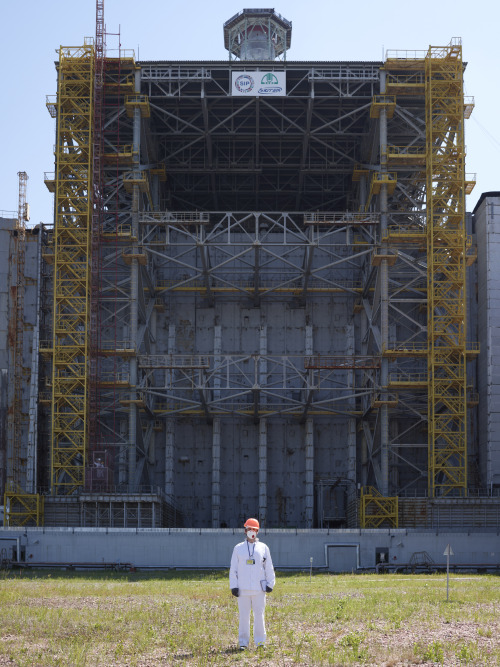 Me standing in front of the Sarcophagus at Chernobyl. Half an hour after this picture I was inside Reactor No.4's control room. An hour later I was buying a souvenir mug which my wife immediately threw out when I got home.