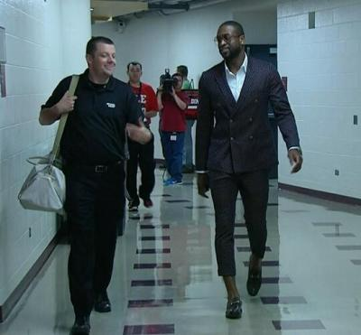Dwyane Wade arriving at Game 4 in Chicago on Monday wearing aGucci Cropped Pants Suit…thoughts?
