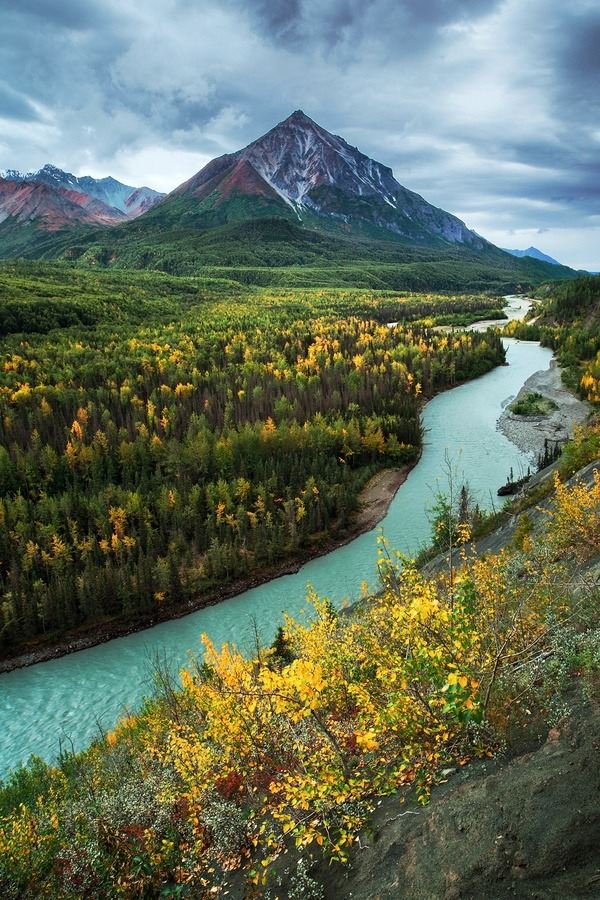 matsvri:  King Mountain and the Matanuska River ✕ Joe Ganster  Its headwaters, of the Matanuska River, are at Matanuska Glacier in the northern Chugach Mountains, approximately 100 miles (160 km) northeast of Anchorage. It flows generally west-southwest through the Mat-Su Valley, between the Chugach range to the south and the Talkeetna Mountains to the north. It flows past Chickaloon, Sutton-Alpine Palmer and enters Knik River before finally entering the Knik Arm of Cook Inlet from the northeast approximately 25 mi (40 km) northeast of Anchorage.
