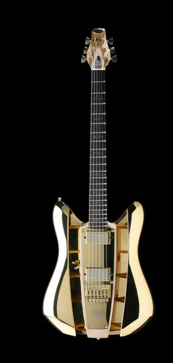 ": RKS Guitars - ""Gold Rush.""RKS is a design firm that is best known for creating the latest version of the Panaflex camera, an insulin pump, and the Teddy Ruxpin doll. For a brief period of time, from roughly 2003-2007, it produced RKS Guitars and partnered with Dave Mason to develop signature models (Mason was actually a partner in the company). RKS's instruments, based on the structure of a fe male body and skeleton, had interchangeable body shells—the bouts—and pickguards. The guitars were primarily constructed of composite, but when tone woods were used, they were hardly exotic; the wood came from American tree farms. The neck-through-body-construction allowed for openings in the body such that the pickup selector switch was situated in the acoustic cavity and not on the body top. The Gold Rush model shown here was a hollowbody electric. The company won numerous design awards but didn't quite sell enough to keep the business going."