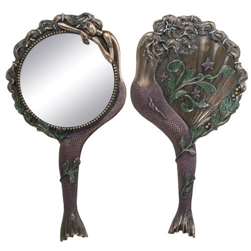 amishyou:  mermaidboner:  antique handheld mermaid mirror   I want it