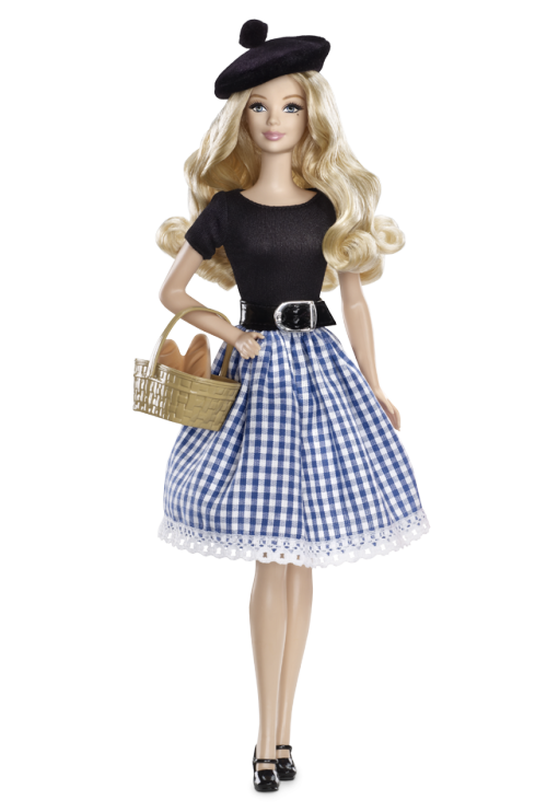 "FranceBarbie® Doll Bonjour! From the French countryside where artists find inspiration and fields of lavender grow, comes a Barbie® doll in a gingham skirt, short-sleeve top, Mary Jane pumps, shiny belt and kicky beret. So très jolie! Includes ""passport,"" country stickers and French ""baguettes."""