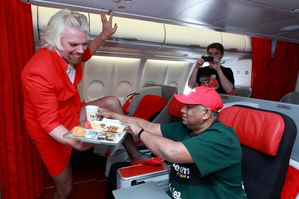 Richard Branson - Sir Richard Branson serving @tonyfernandes on board @AirAsia X's flight D7 237 fro
