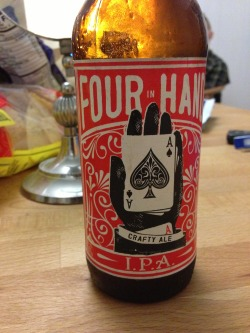 World Brews' Four in Hand IPA during a poker game (picked up at Whole Foods, Berkeley). A 2 of 4. Relatively amber in color for an IPA - and the malt character reflects this - a bit nutty and caramel-y. A decent amount of bitterness in the body, but not a ton in the nose. Easy to drink, but more of a maltier pale ale than a full-bore IPA.